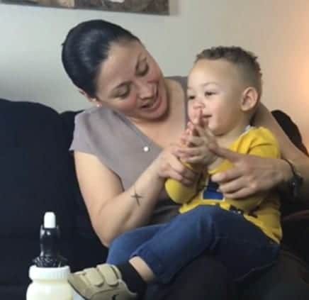 Woman holding child on her lap