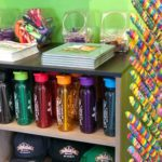 Water bottles and caps at the Squad Shoppe