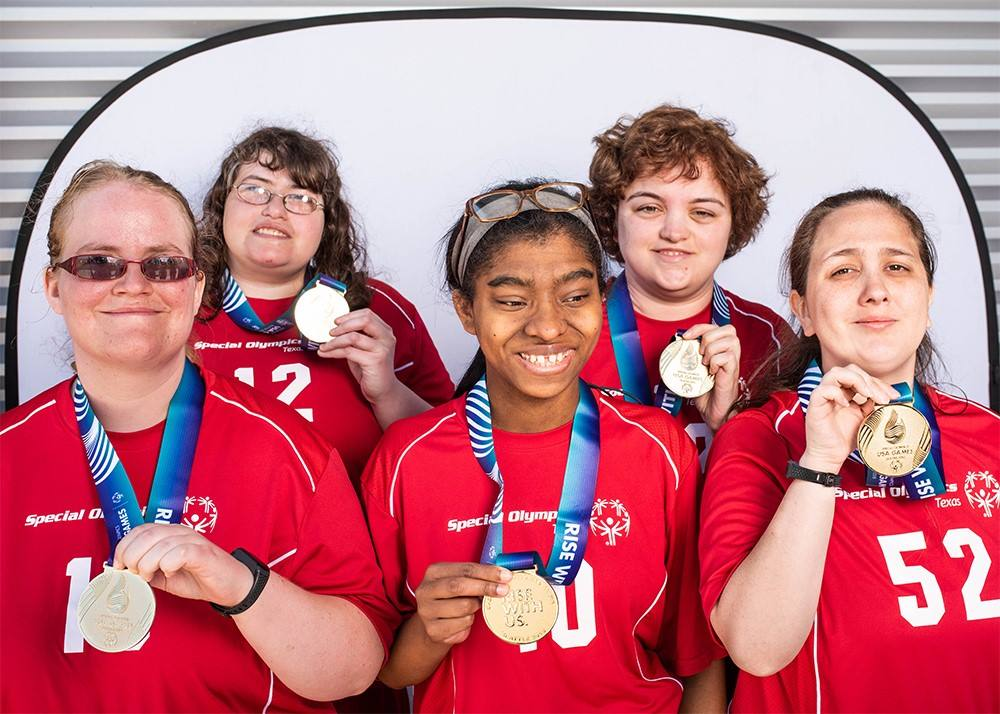 Special Olympics participants showing off medals